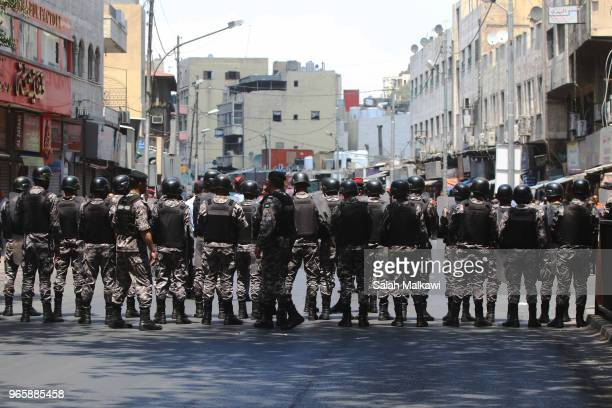 Antiriot police take places in a downtown street in Amman after the Friday prayers as protests hit Jordan refusing an income tax law on June 1 2018...