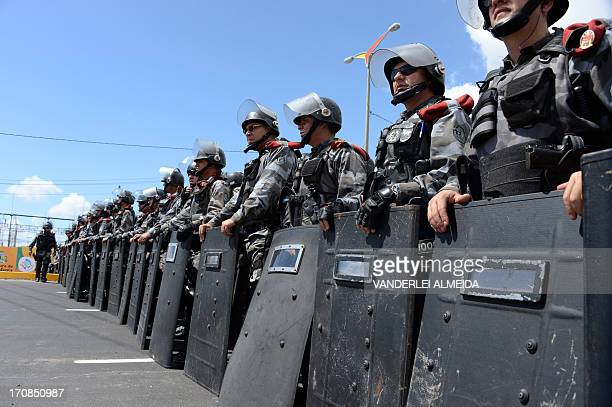 Antiriot police units block a street in Fortaleza Northern Brazil on June 19 2013 during a protest of what is now called the 'Tropical Spring'...