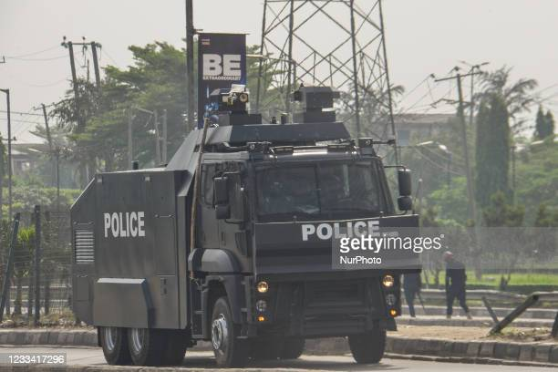 Anti-riot police van waiting for detained protesters protester during civil demonstration at the Gani Fahweyinmi Park, Ojota district of Lagos,...