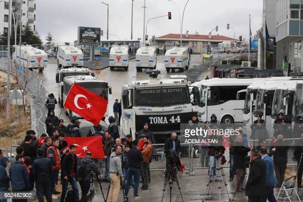 Antiriot police vehicles form a blockade in a sealed off area surrounding the Dutch embassy on March 12 2017 in Ankara for 'security reasons' as a...