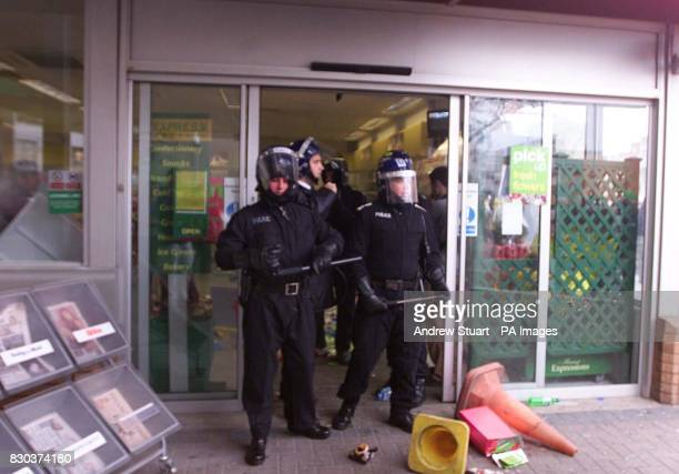 Antiriot police walk from the BP Garage in Kennington Lane south east London Thousands of anticapitalist demonstrator have gathered for the last day...