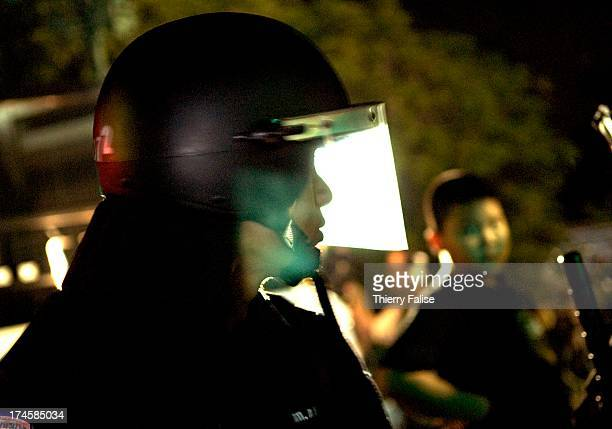 A antiriot policeman looks at a colleague Thousands of demonstrators have defied warnings of a crackdown from the Thai Prime minister Samak...