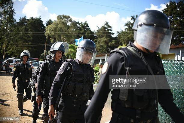 Antiriot policemen arrive at the Pavon maximum security prison in Fraijanes municipality about 20 km from Guatemala City after at least two people...