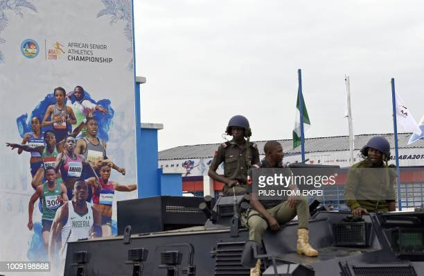 Antiriot policemen guard during the opening of the 21st African Senior Athletics Championships at the Stephen Keshi Stadium in Asaba Delta State...