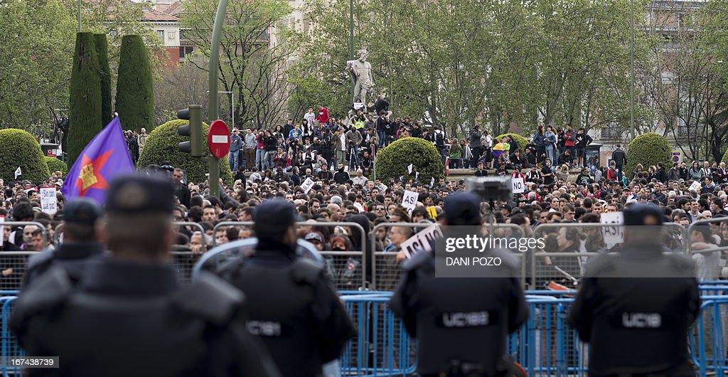 Anti-riot policemen stand guard as they block the street leading to the Spain's parliament (Las Cortes) during an anti-government demonstration in Madrid on April 25, 2013. A thousand of people, mostly youths, gathered today evening near the Spanish parliament in Madrid in response to a call by a hardline protest movement for demonstrators to 'Besiege Congress' indefinitely to force the government to quit.