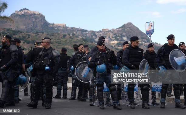 Antiriot policemen stand guard during a rally against the G7 Summit in GiardiniNaxos near the venue of the G7 summit of Heads of State and of...