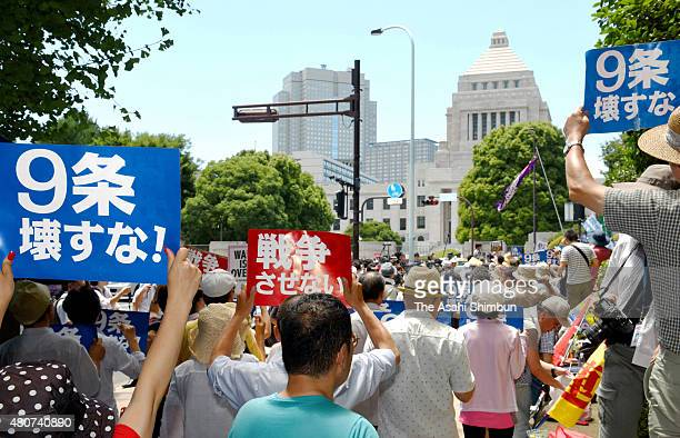 Antisecurity legislation protesters holding banners of 'No War' 'Protect Article 9' during a rally in front of the diet building on July 15 2015 in...