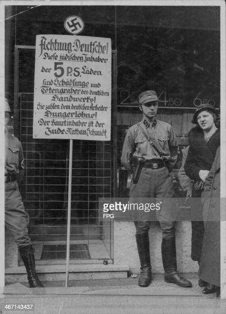 Antisemetic riots taking place and antiJewish signs displayed Berlin Germany circa 19321936
