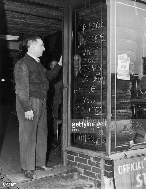 Antisemitic graffiti in the Bronx New York during the presidential campaign of 1944 It exhorts the reader to vote for Republican candidate Thomas...