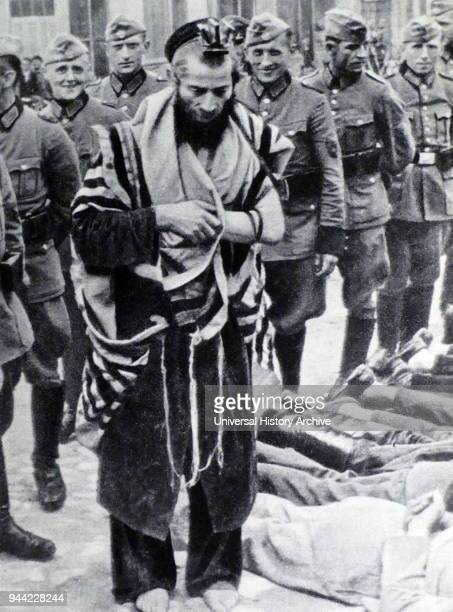 Anti-Semitic measures taken by German forces, during the Nazi Occupation of Poland, in World War Two. July 31, 1940; Olkusz, Poland, on 'Bloody...