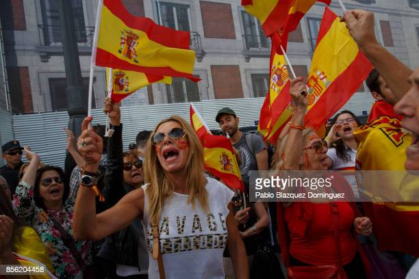 Antiseparatist demonstrators hold Spanish flags and shout slogans during a protest in support of Spain's unity as Catalonian votes in referendum on...