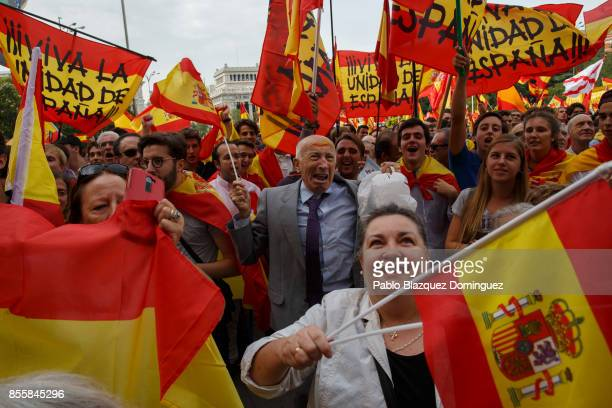 Antiseparatist demonstrators hold Spanish flags as they take part in a protest in support of Spain's unity ahead of Sunday's Catalan referendum vote...