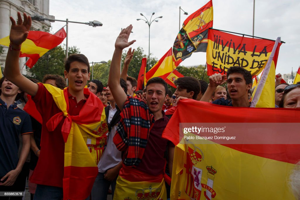 Anti-separatist demonstrators hold Spanish flags as they take part in a protest in support of Spain's unity ahead of Sunday's Catalan referendum vote on September 30, 2017 in Madrid, Spain. The Catalan government is keeping with its plan to hold a referendum, due to take place on Octorber 1, which has been deemed illegal by the Spanish government in Madrid.