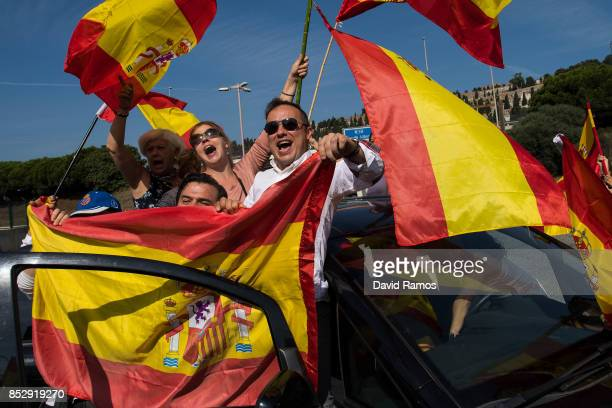 Antiseparatist demonstrators show their support to National Police and Civil Guard police officers who are housed on ferry boats at Barcelona port on...