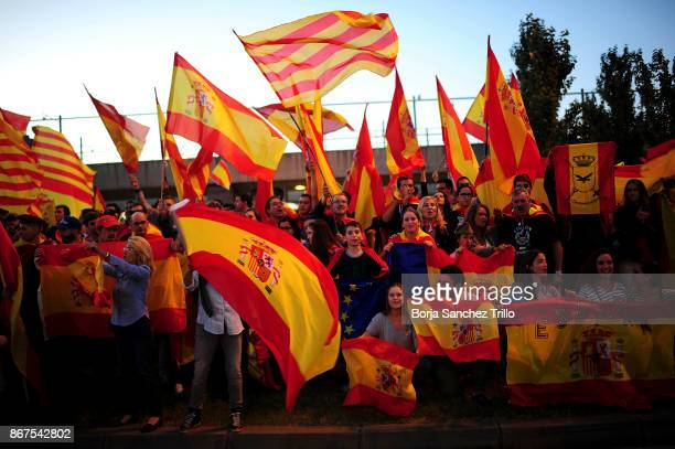 Antiseparatist supporters wave Spanish and Catalan flags during a demonstration in favor of Spanish National Police and Civil Guard through...