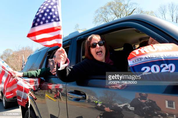 Anti-shutdown protesters take part in a Liberate Massachusetts rally outside the home of Massachusetts Governor Charlie Baker in Swampscott on April...