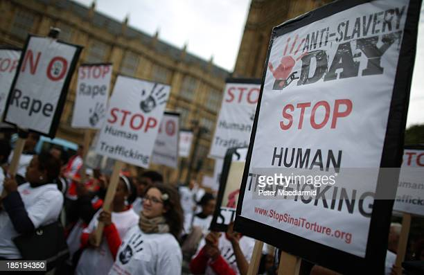 Antislavery activists rally outside Parliament on October 18 2013 in London England Antislavery day falls on October 18th every year and provides an...
