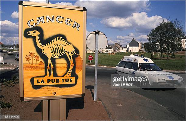 AntiSmoking campaign the students use cigarette ads to condemn tobacco use in Quimper France on April 22 1991
