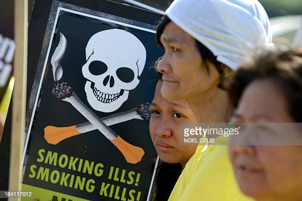 Antismoking protesters hold a rally at the entrance gate of the World Trade Center in Manila on March 20 2013 where the world's biggest tobacco trade...