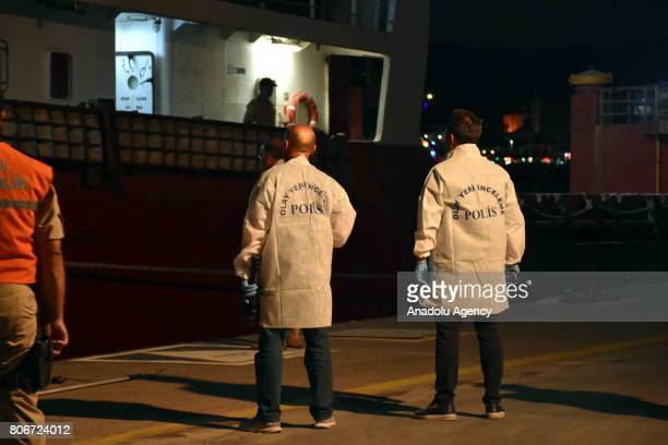 """Anti-smuggling and organized crime branch police team inspect with a narcotic detection dog named """"Zeta"""" after Greek coastal guard boats allegedly..."""