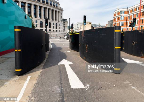 anti-terror security barriers on a street. - terrorism stock pictures, royalty-free photos & images