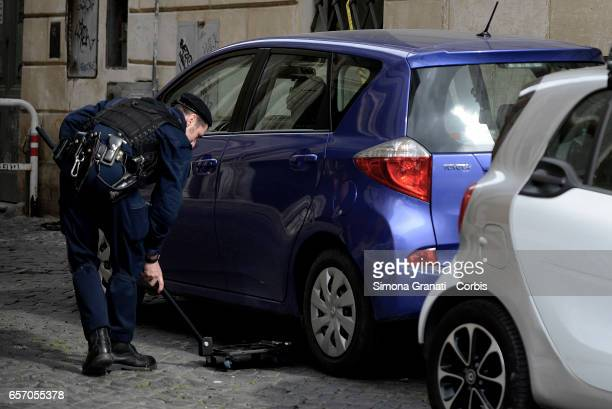 Antiterrorism police carry out checks with dogs in the Capitol area on March 23 2017 in Rome Italy The Ministry of the Interior has tightened...