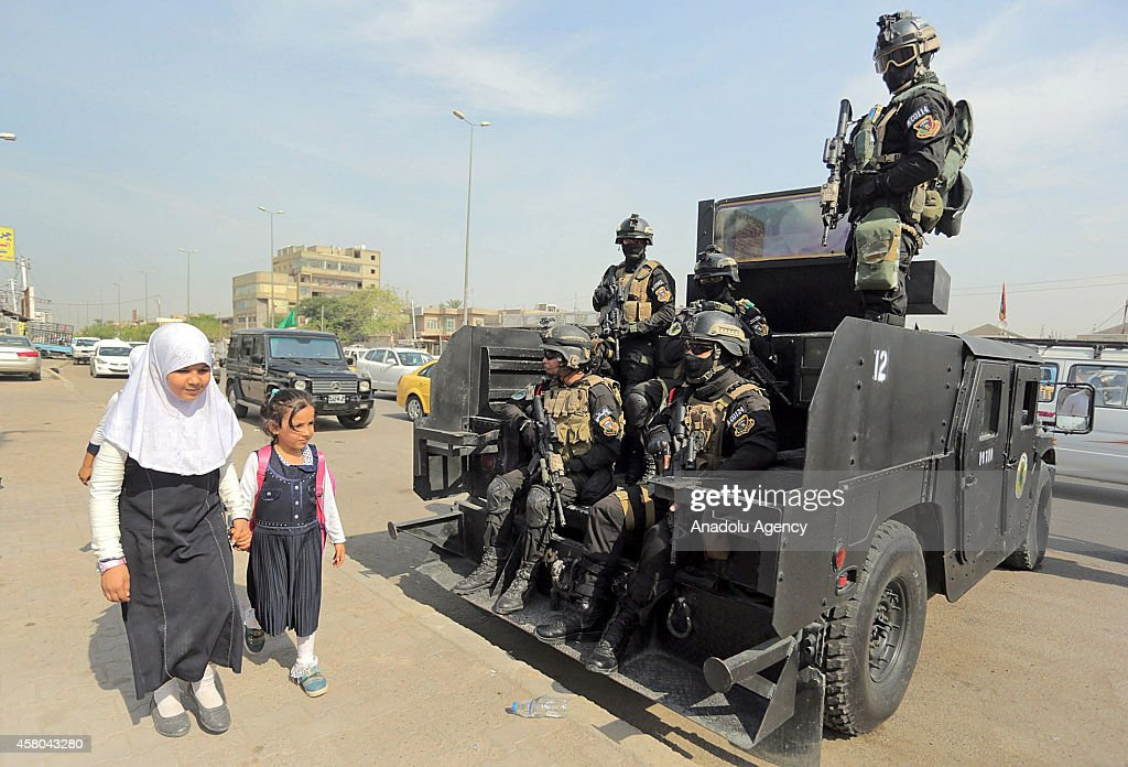 Anti-terrorism security team members keep guard at a check point on October 28, 2014 in Baghdad, Iraq, as tightened security measures are taken across Baghdad.