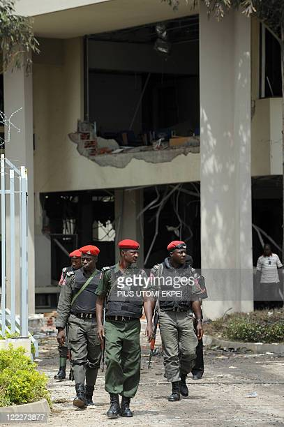 Antiterrorist squad of the Nigeria police inspects the scene of the bomb blast at the United Nations building on August 27 in Abuja Investigators...