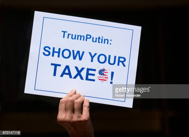 AntiTrump activists in Santa Fe New Mexico participate in a 'Tax Day' rally protesting President Donald Trump's refusal to release his federal income...