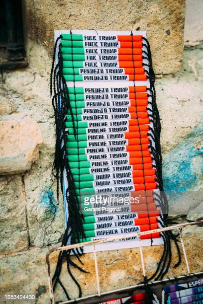 """anti-trump bracelets in a street stand in mexico - """"gerard puigmal"""" stock pictures, royalty-free photos & images"""