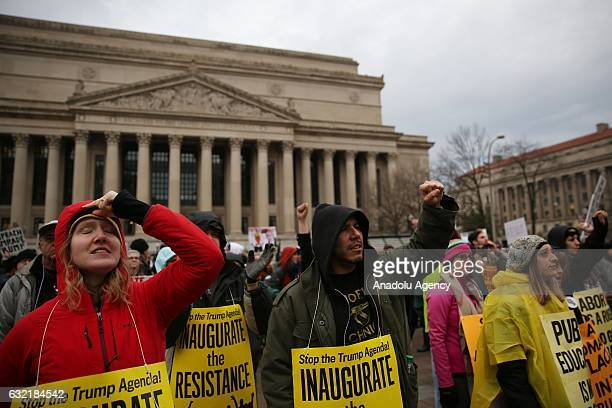AntiTrump demonstrators hold banners on the inauguration day of Donald Trump the 45th President of the United States in Washington United States on...