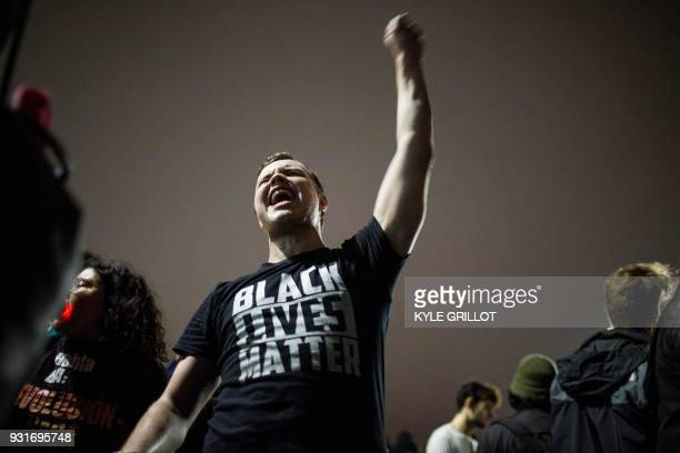 TOPSHOT AntiTrump protester Ian Jameson of Pasadena chants with others near the president's fundraiser in Beverly Hills California March 13 2018 /...