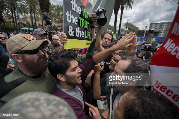 AntiTrump protesters and Trump supporters clash outside a campaign rally by presumptive GOP presidential candidate Donald Trump at the Anaheim...