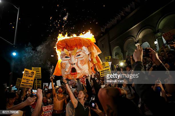 AntiTrump protesters burn an effigy of the presidentelect Donald Trump outside City Hall in Los Angeles Calif on Nov 9 2016