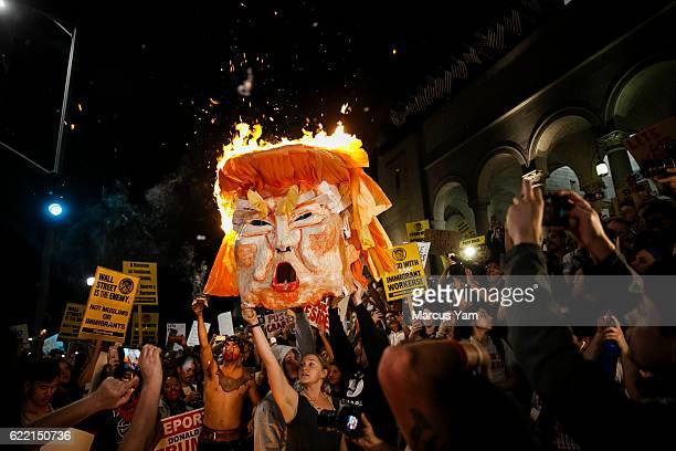 LOS ANGELES CALIF WEDNESDAY NOVEMBER 9 2016 AntiTrump protesters burns an effigy of the presidentelect Donald Trump outside City Hall in Los Angeles...
