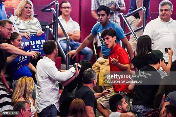 AntiTrump protesters clash with supporters of US Republican presidential candidate Donald J Trump during a campaign rally at the BBT Center in Ft...