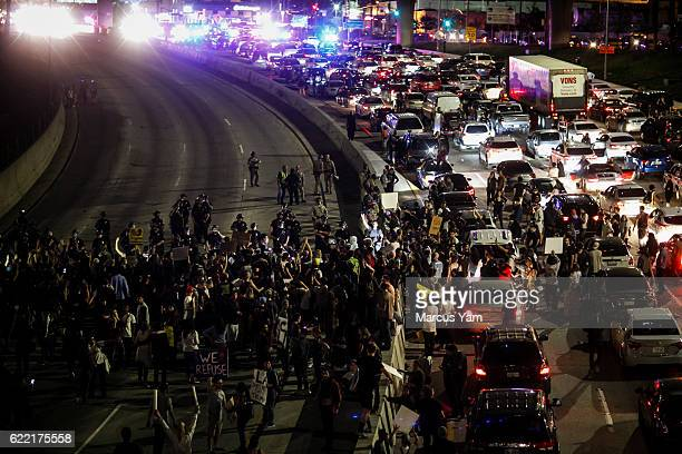 AntiTrump protesters flood the 101 freeway as they protest the PresidentElect Donald Trump in Los Angeles Calif on Nov 10 2016