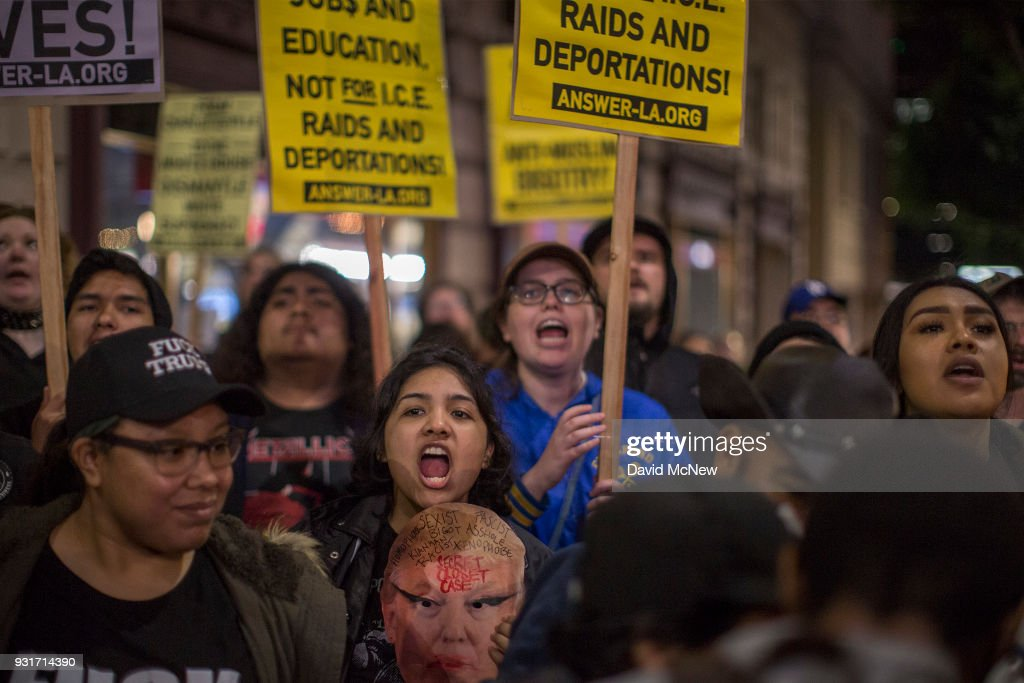 Anti-Trump protesters rally outside the InterContinental Los Angeles Downtown hotel where U.S. President Donald Trump is spending the night during his first visit to California since taking office on March 13, 2018 in Los Angeles, California. Earlier today, the president visited border wall prototypes, addressed Marines and held a high-dollar fundraiser.