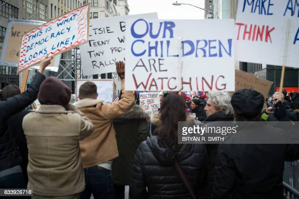AntiTrump protesters shout at supporters of US President Donald Trump during a rally near Trump Tower in Fifth Avenue February 5 2017 in New York /...