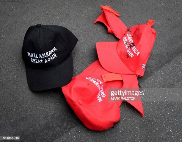 AntiTrump protesters stamp on a 'Make America Great Again' caps outside the Anaheim Convention Center after a rally for Republican presidential...