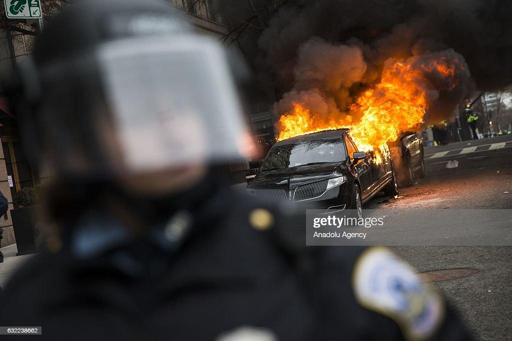 Anti-Trump Protestors Clash with Police, Limousine Set on Fire : News Photo