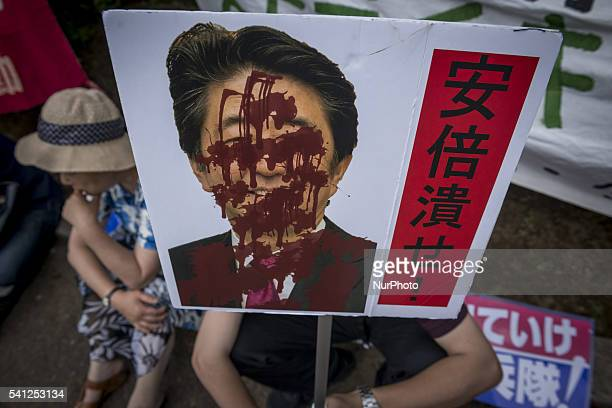AntiUS airbase demonstrators protest the US Airbase relocation to Henoko in front of the Japanese Parliament in Tokyo Japan on June 19 2016 Protests...