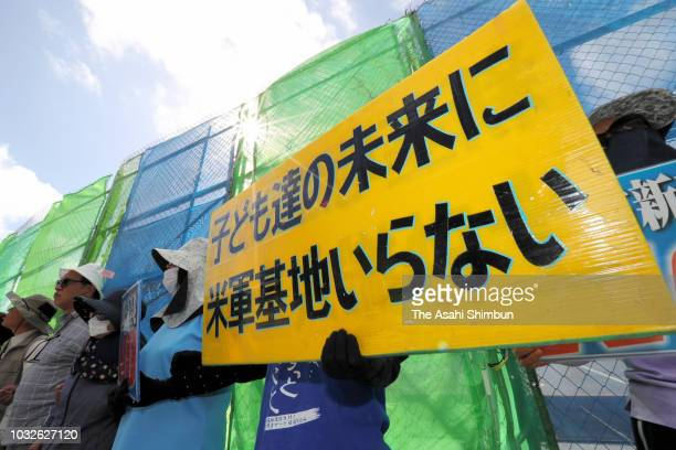 AntiUS base protesters continue protest outside US Camp Schwab as the Okinawa gubernatorial election officially kicks off on September 13 2018 in...