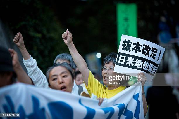 AntiUS base protesters gather in front of Ministry of Defense to protest against the US airbase in Okinawa on Monday July 4 2016 in Tokyo Japan...