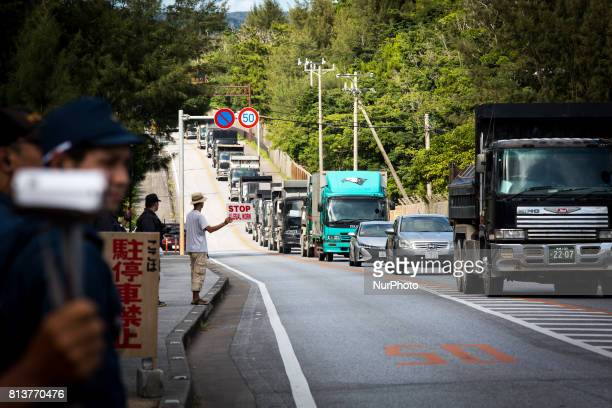AntiUS base protesters were seen removed by riot police as they try to block construction trucks in front of the Camp Schwab gate to protest against...