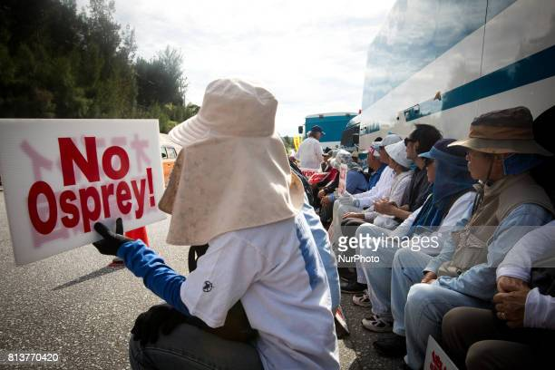 AntiUS base protesters with their placards stage a sit in protest in front of the Camp Schwab gate to protest against the construction of the new US...