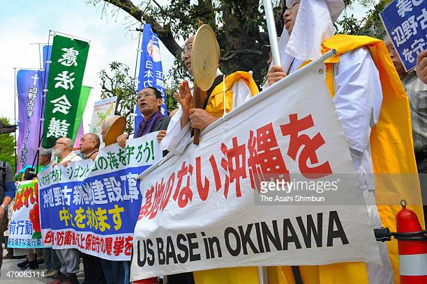 AntiUS base relocation protesters hold a rally while the meeting of Okinawa Prefecture Governor Takeshi Onaga and Japanese Prime Minister Shinzo Abe...