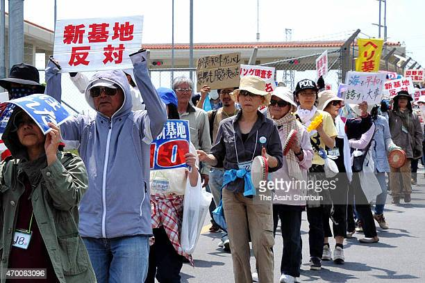 AntiUS base relocation protesters march on in front of the US Camp Schwab while the meeting of Okinawa Prefecture Governor Takeshi Onaga and Japanese...