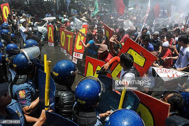 AntiUS protestors clash with riot police using water cannon near the US embassy on April 29 2014 in Manila Philippines US President Barack Obama...