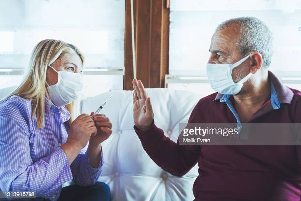 anti-vaccination protest, refusing covid-19 vaccine - social movement stock pictures, royalty-free photos & images